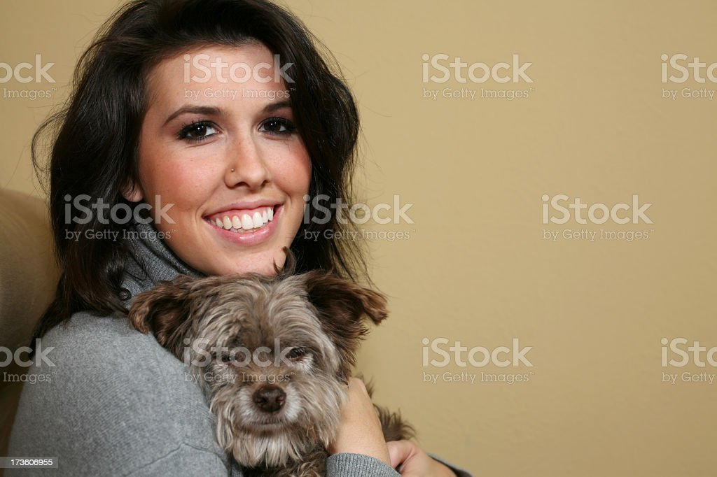 Young Woman And Her Dog Relaxing At Home royalty-free stock photo