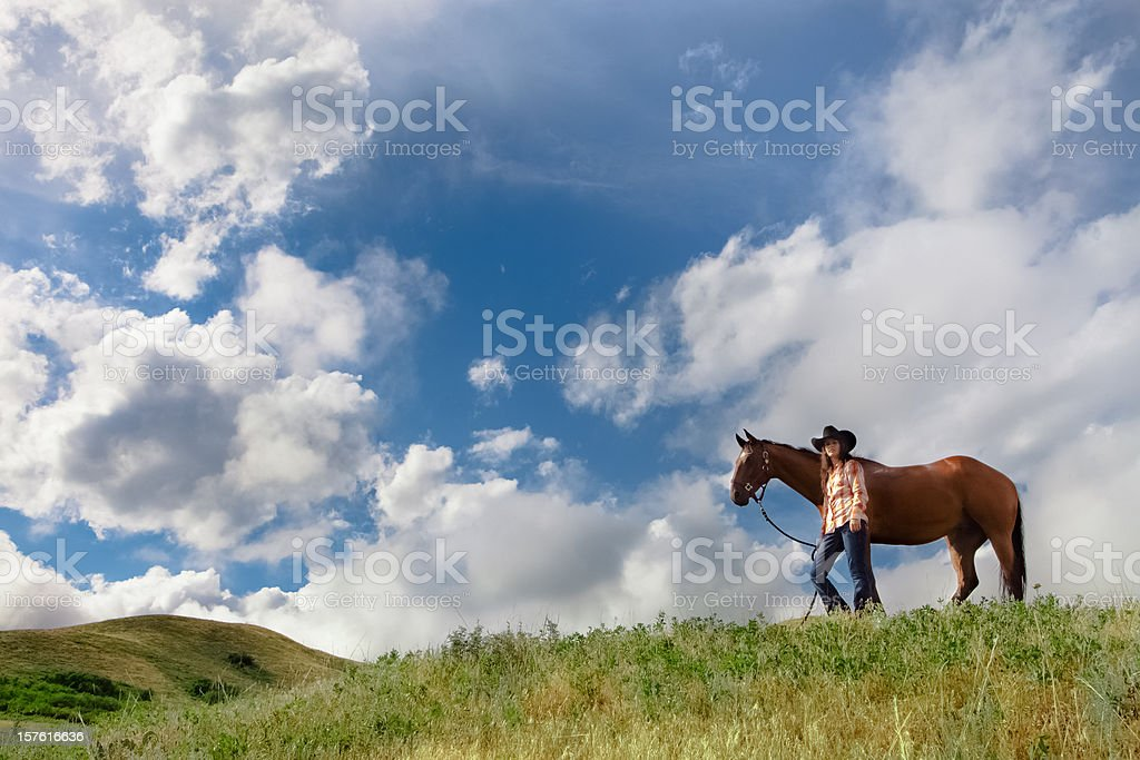 Young Woman And Her Horse On A Hilltop stock photo