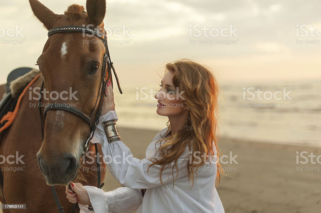 Young woman and horse on sea cost royalty-free stock photo