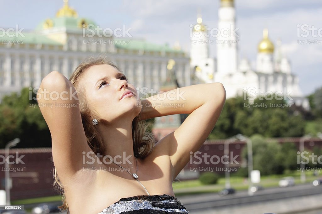 Young woman and Kremlin on background royalty-free stock photo
