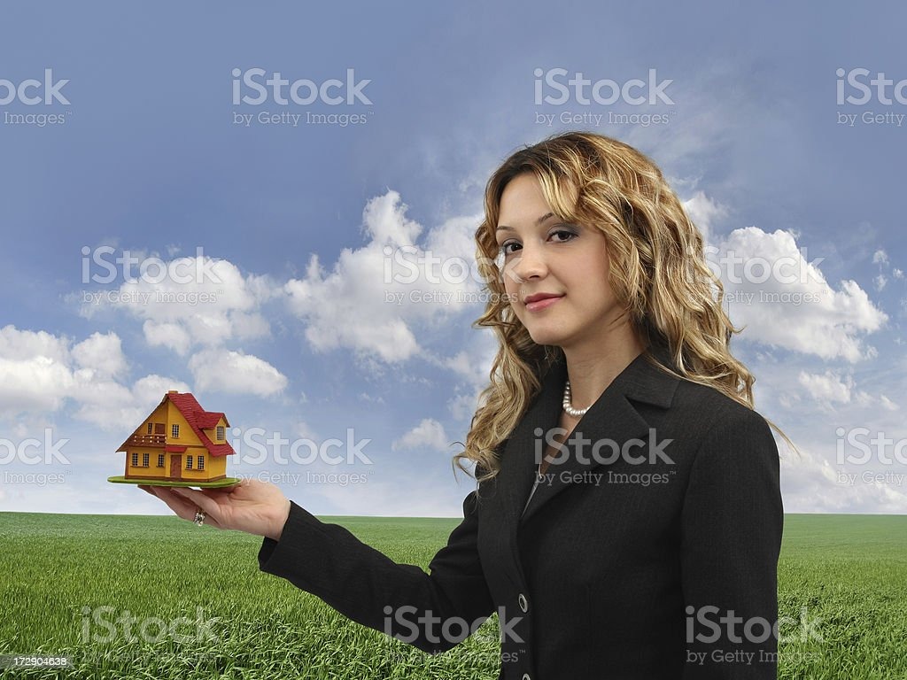 Young Woman And Little House royalty-free stock photo