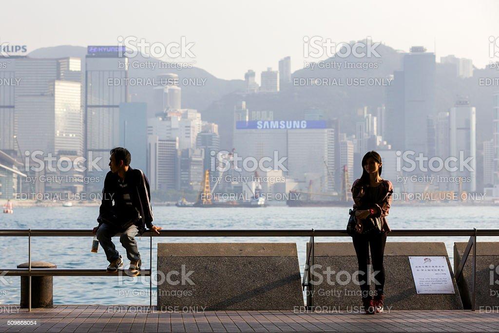 Young woman and man at the Tsim Sha Tsui Promenade stock photo