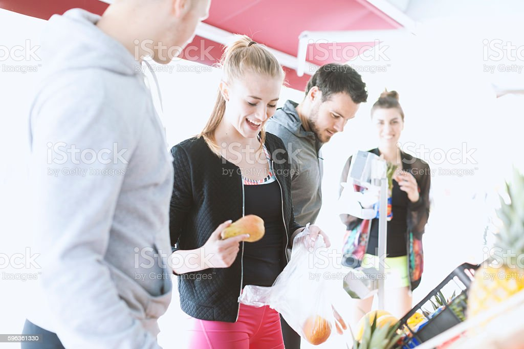 Young Woman and Man Choosing Healthy Food at Vegetable Market royalty-free stock photo