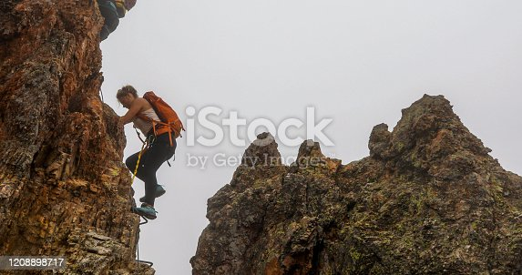They are tied into the cable connecting them to the rock face