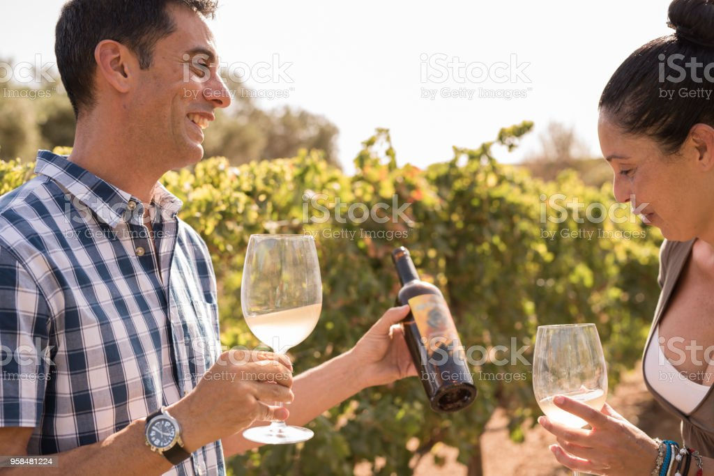 A young woman and man drinking wine stock photo