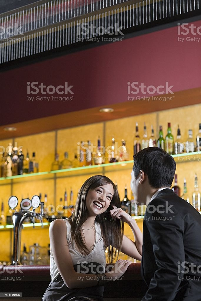 Young woman and man in a bar royalty-free 스톡 사진