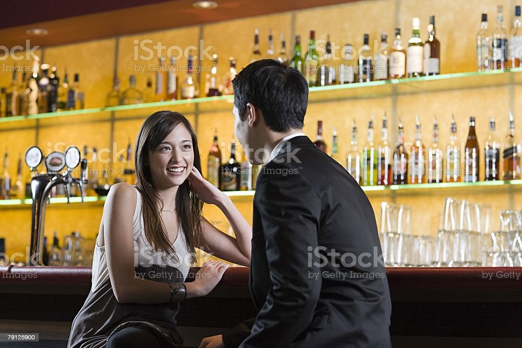Young woman and man in a bar 免版稅 stock photo