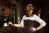 istock Young woman and man in steampunk stile make a coffee 170046536