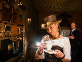 istock Young woman and man in steampunk stile make a coffee 170110155