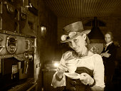 istock Young woman and man in steampunk stile make a coffee 170110161