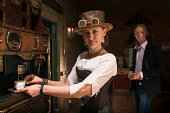 istock Young woman and man in steampunk stile make a coffee 170454901