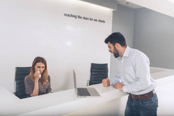 Young woman and man in the business office stock photo