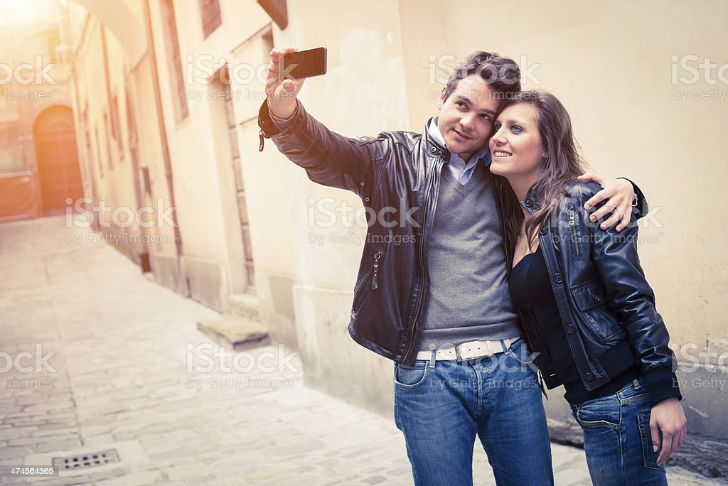 Young woman and man taking a photo royalty-free stock photo
