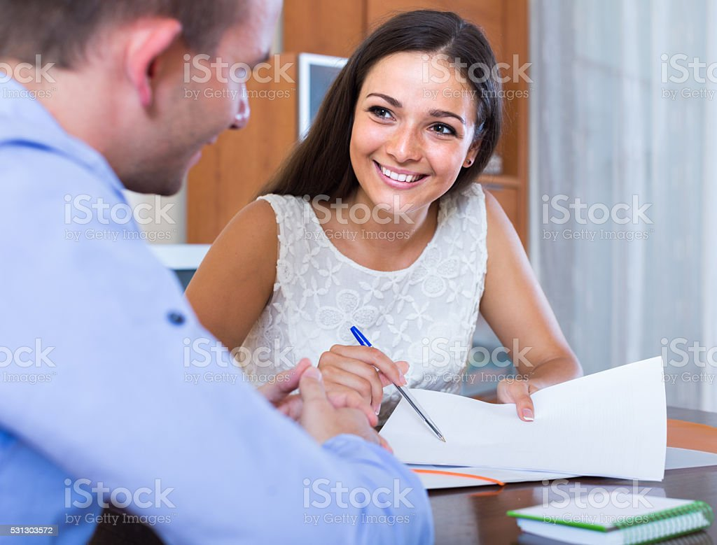 young woman and man with financial documents in agency stock photo