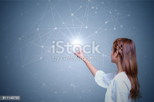 istock young woman and mesh network 811140732