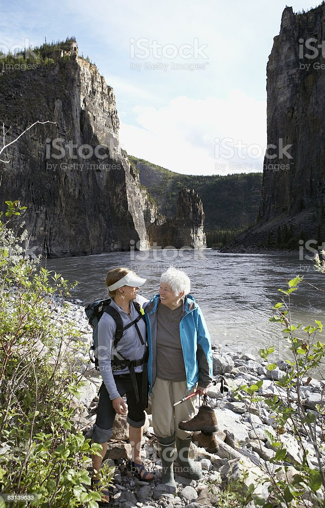 young woman and old woman near river shore ロイヤリティフリーストックフォト