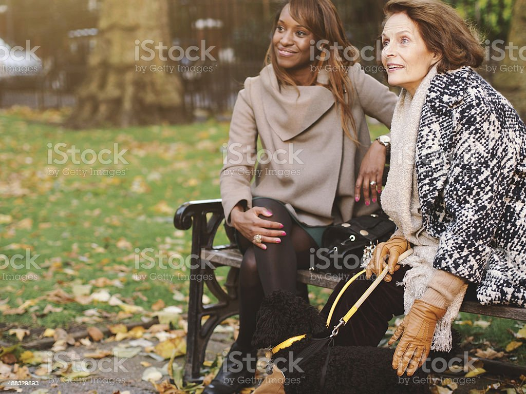 Young woman and senior lady in a park royalty-free stock photo
