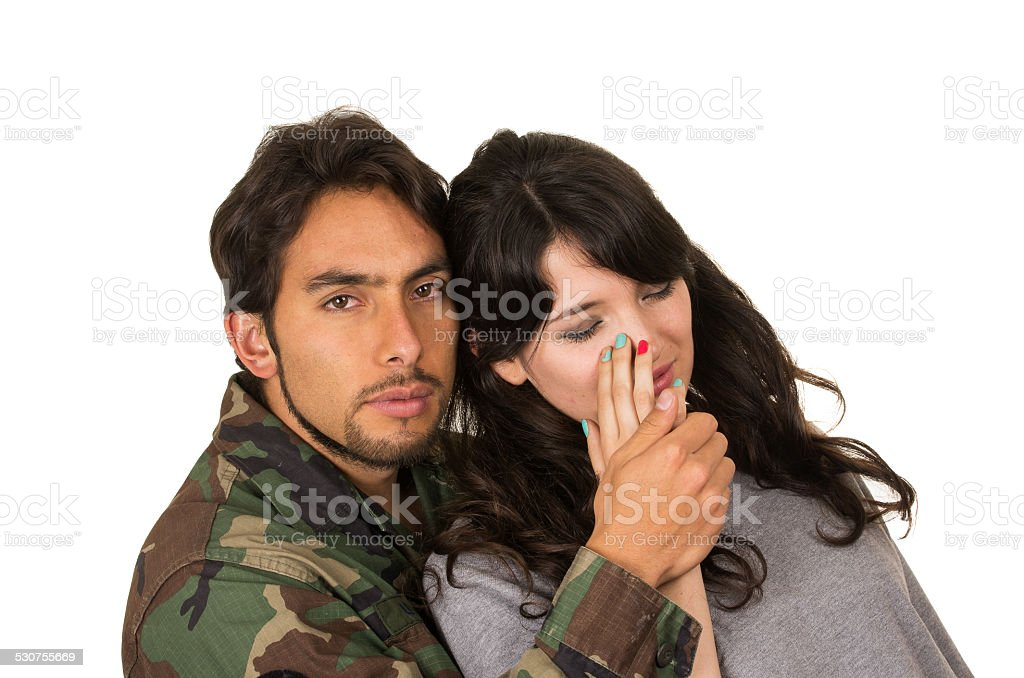 young woman and soldier in military uniform say goodbye deployment stock photo