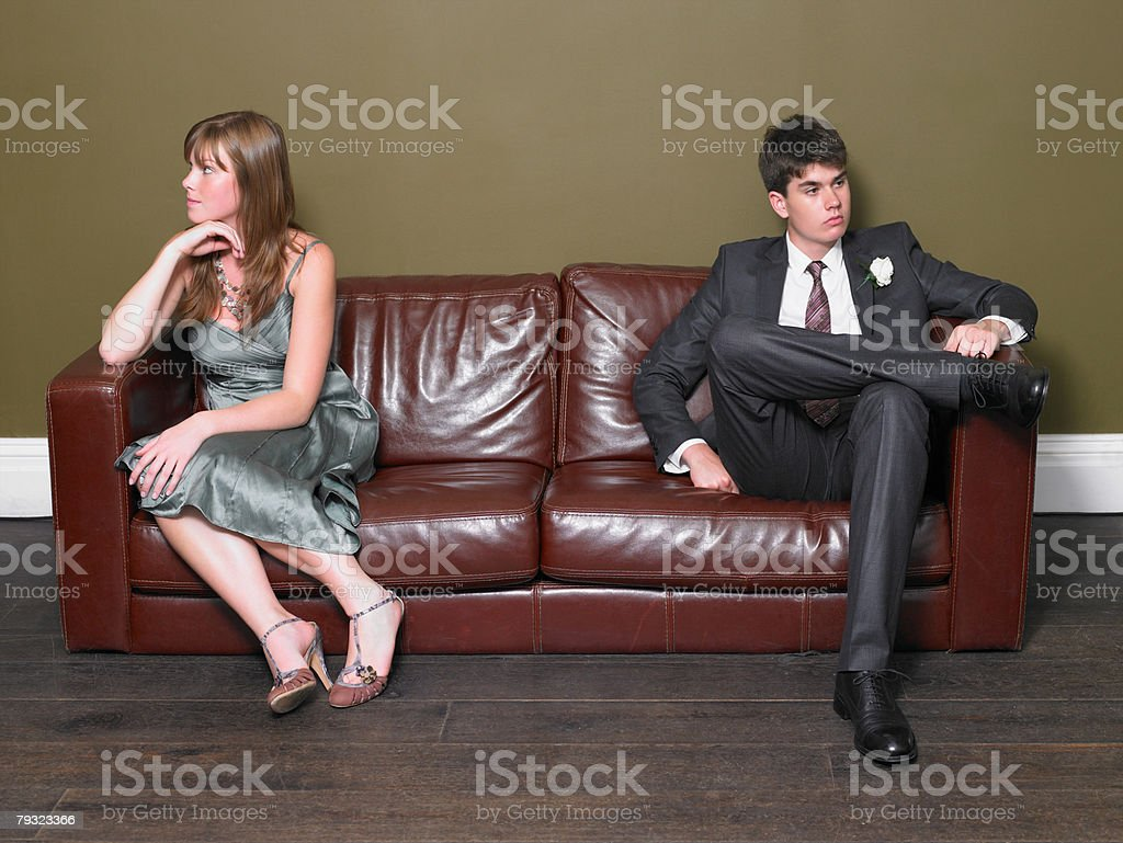 A young woman and teenage boy ignoring each other royalty-free 스톡 사진