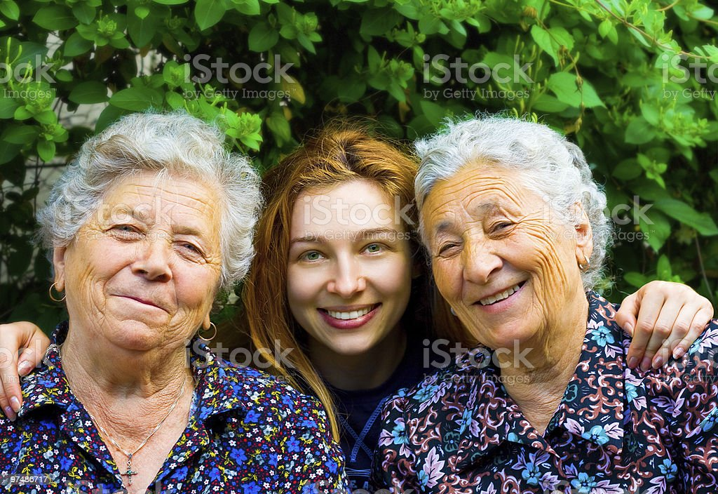 Young woman and two senior ladies royalty-free stock photo