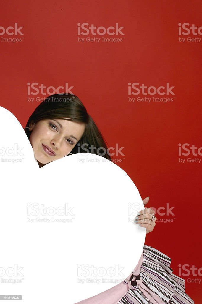 Young woman and White heart 4 royalty-free stock photo