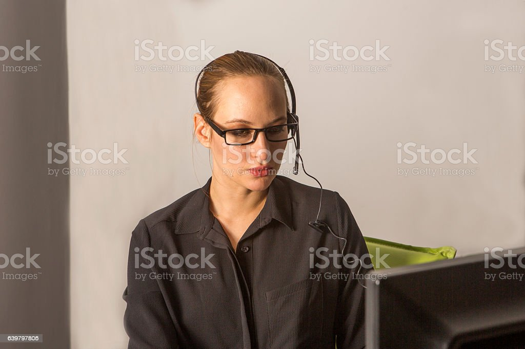 young woman answering phone at callcenter in istanbul turkey stock photo