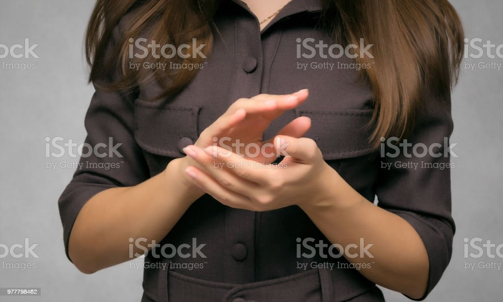 Young woman applauding. stock photo