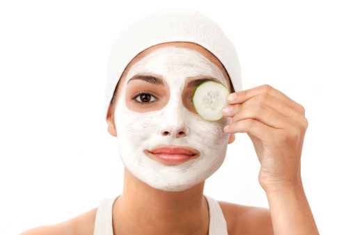 Young Woman Applying A Facial Mask Isolated Stock Photo - Download Image Now