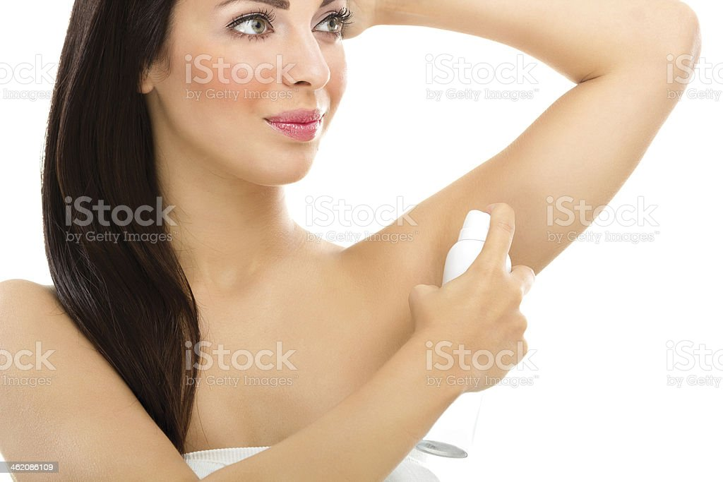 Young woman applying deodorant - Royalty-free Adult Stock Photo
