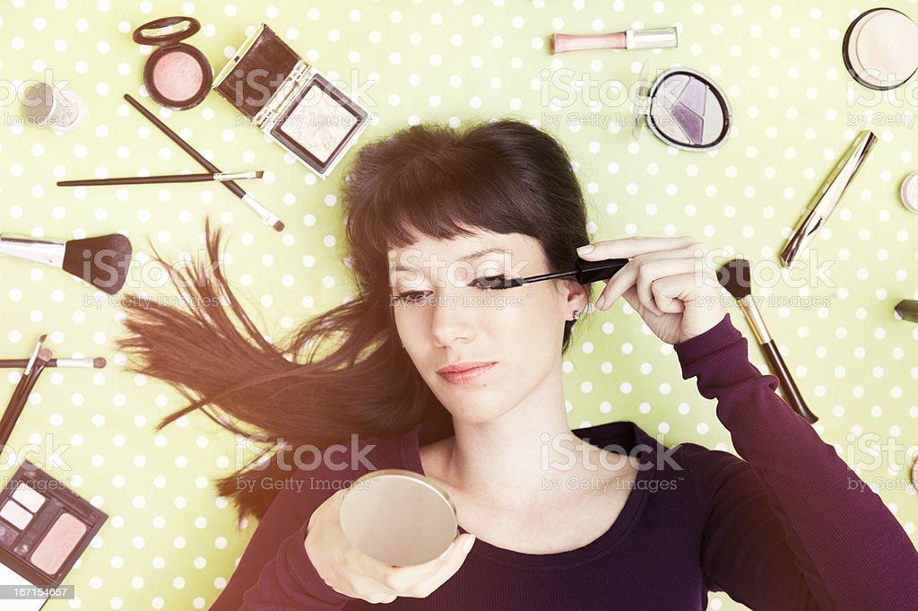 Young woman applying mascara stock photo