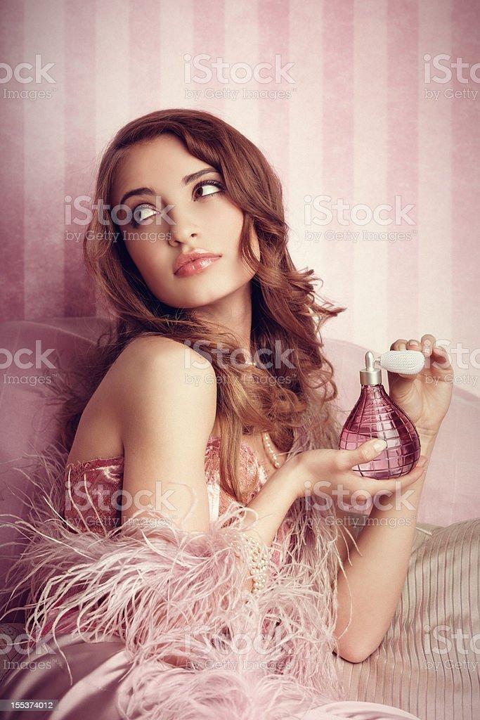 Young woman applying perfume royalty-free stock photo