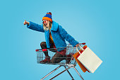 istock Young woman approving crazy shopping 1155208843