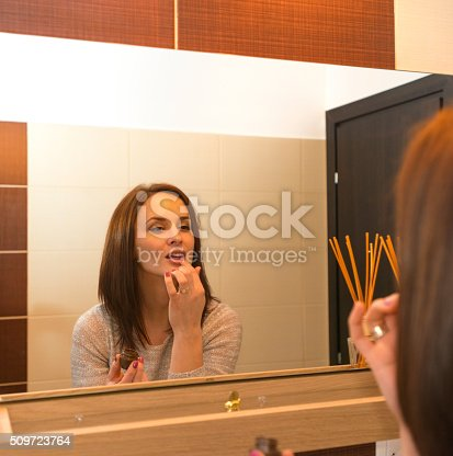 istock young woman arranging herself in the bathroom in the morning 509723764