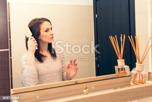 istock young woman arranging herself in the bathroom in the morning 509724356