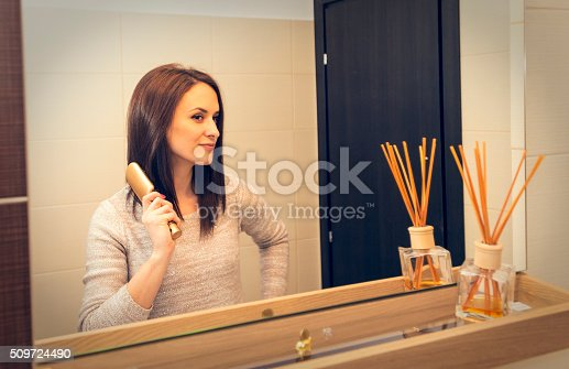 istock young woman arranging herself in the bathroom in the morning 509724490