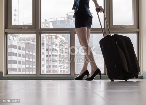 istock Young woman arriving in a new city. 497510067