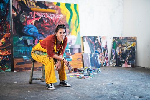 istock Young woman artist in studio. 1187482560