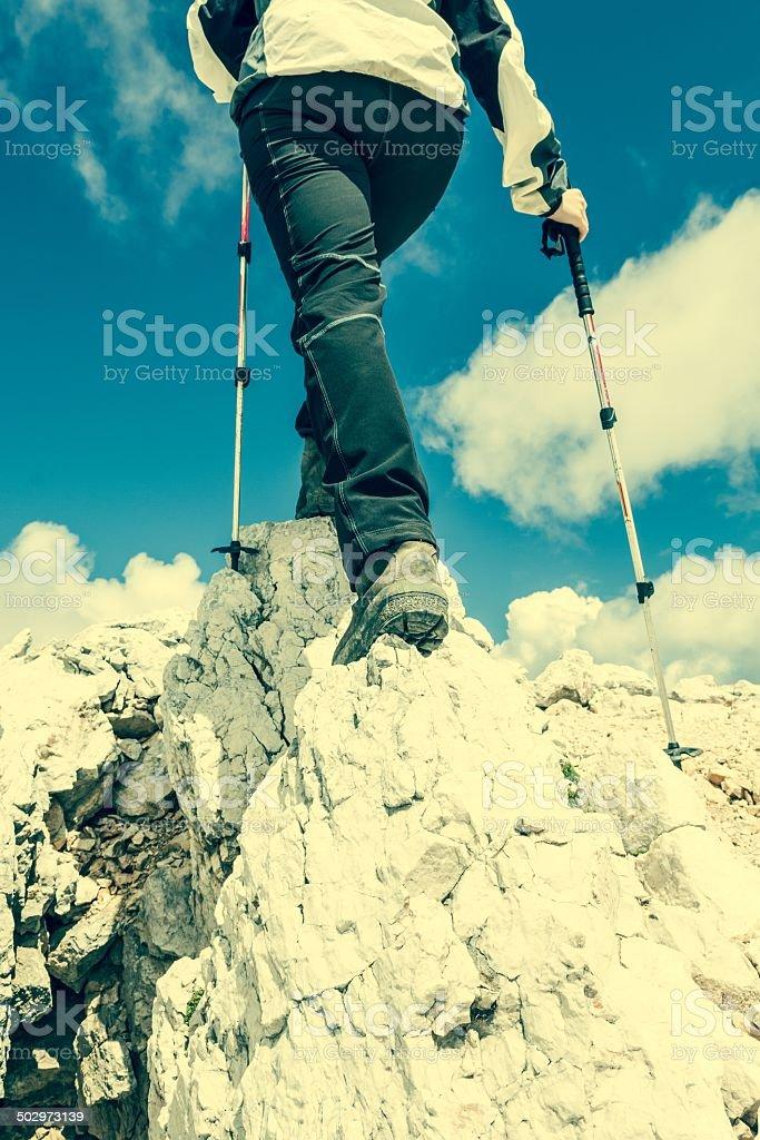 Young woman ascending a mountain ridge royalty-free stock photo