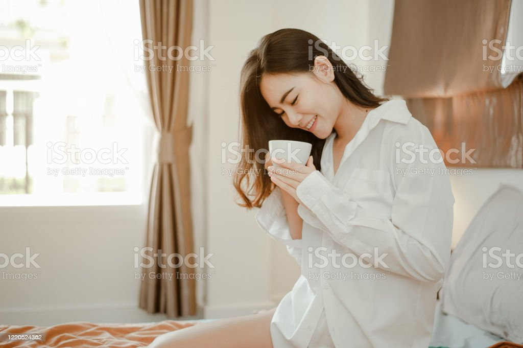 Home alone hot women Young Woman Asia Living At Home Relaxing And Drinking Cup Of Hot Coffee In The Bedroom On Holiday Asian Asia Relax Alone Technology Lifestyle Concept Stock Photo Download Image Now Istock
