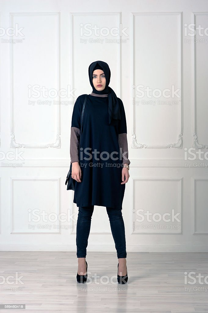 young woman oriental appearance in modern  clothes stock photo