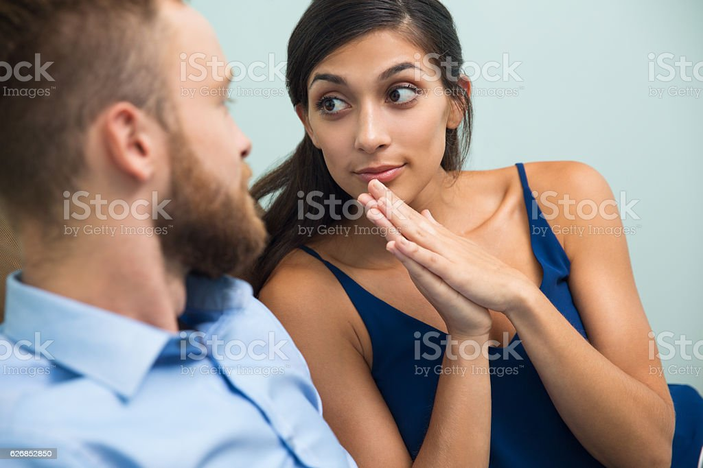 Young woman asking her husband about something stock photo