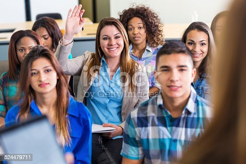 600055398 istock photo Young woman asking question during orientation or seminar 524479711