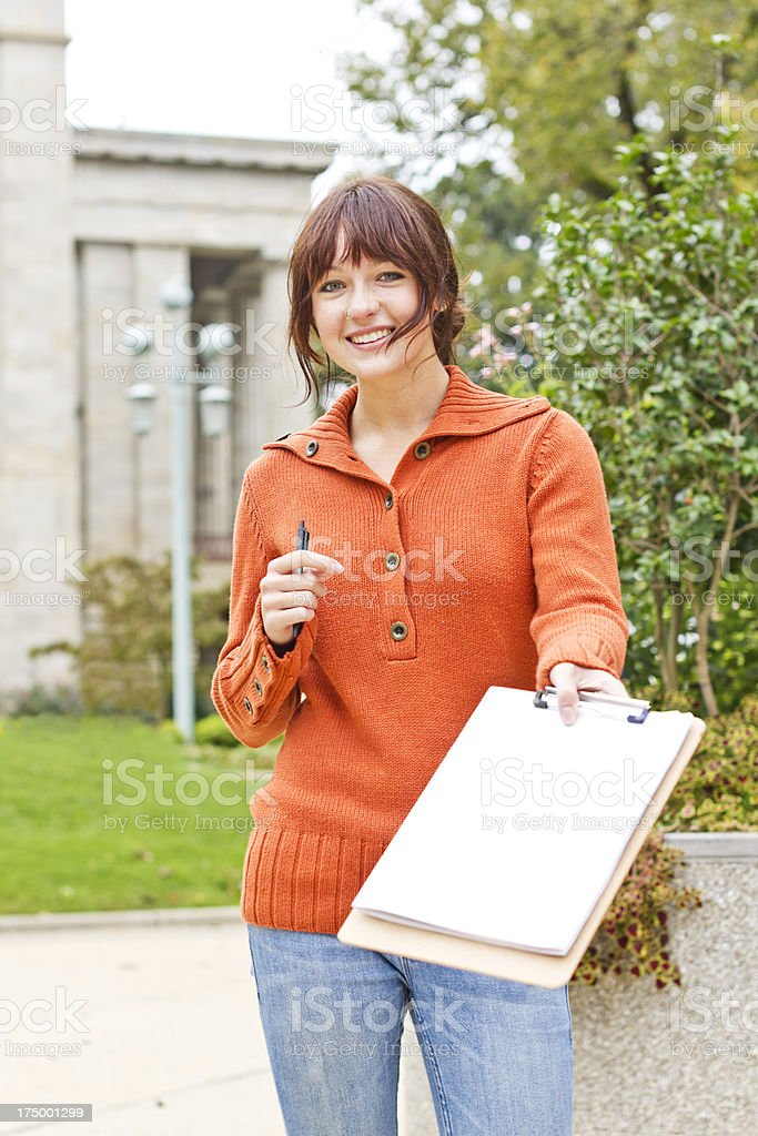 Young Woman Asking You to Sign Petition stock photo