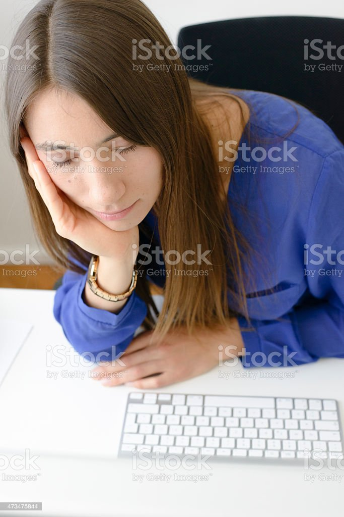 Young Woman Asleep at Her Office Desk stock photo