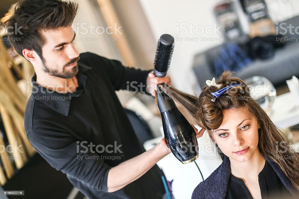 Young woman at a hair salon stock photo