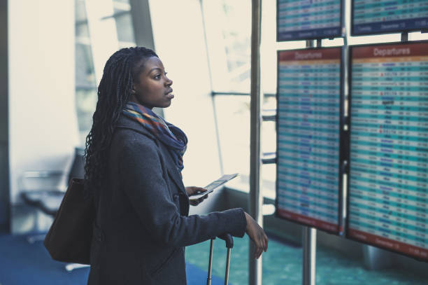 young woman at airport - getting on stock photos and pictures