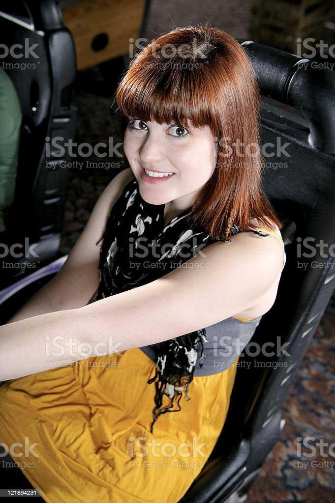 Young Woman at an Arcade royalty-free stock photo