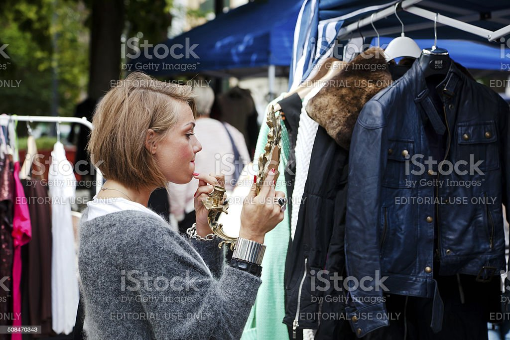 Young woman at an outdoor market. stock photo