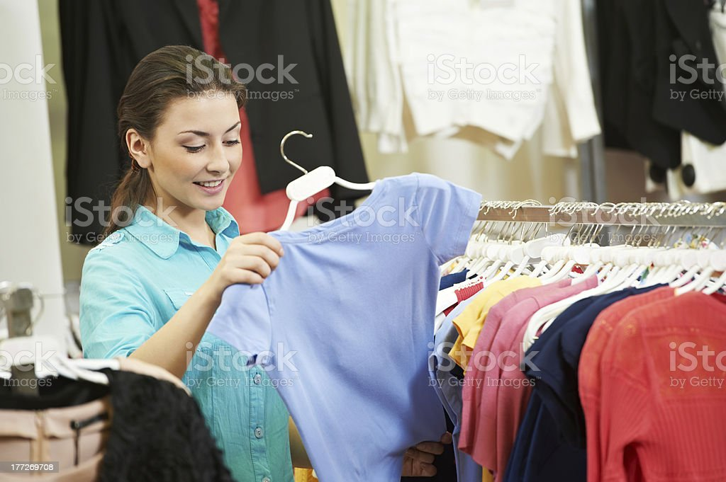Young woman at apparel clothes shopping royalty-free stock photo
