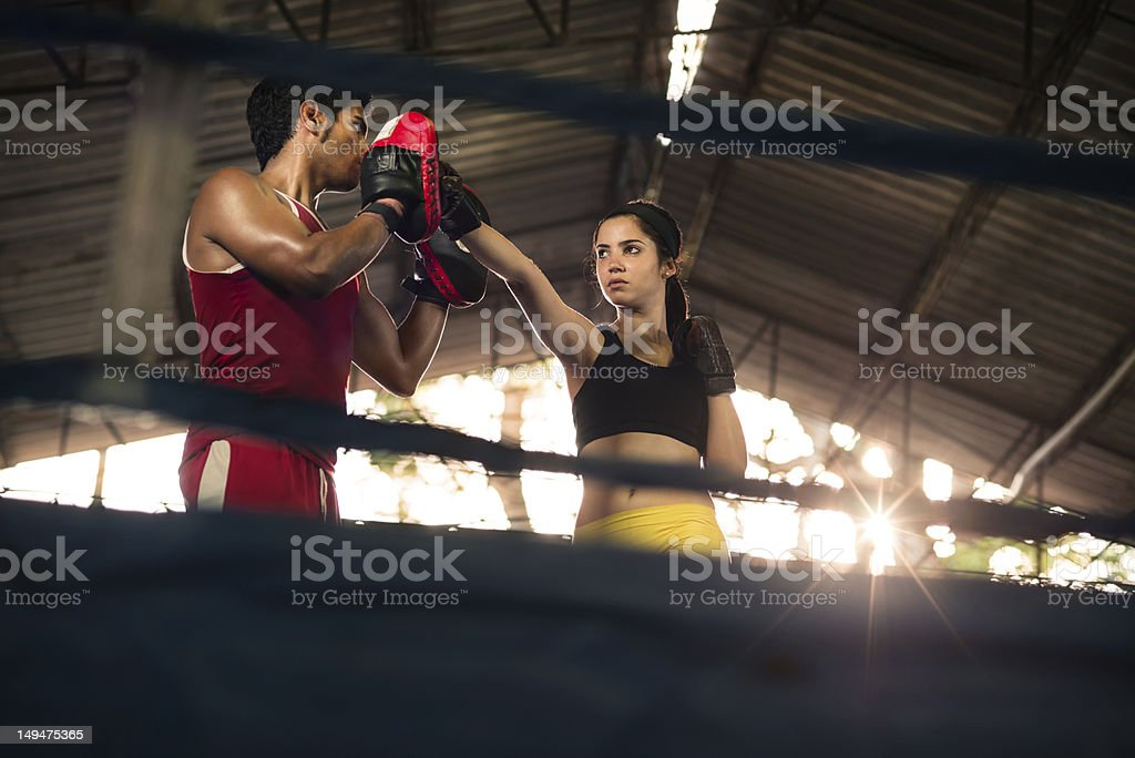 Young woman at boxing and self defense course stock photo